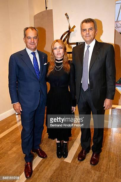 Actress Josephine de la Baume standing between Ferruccio Ferragamo and Leonardo Ferragamo attend the Re Opening of Salvatore Ferragamo Boutique at...
