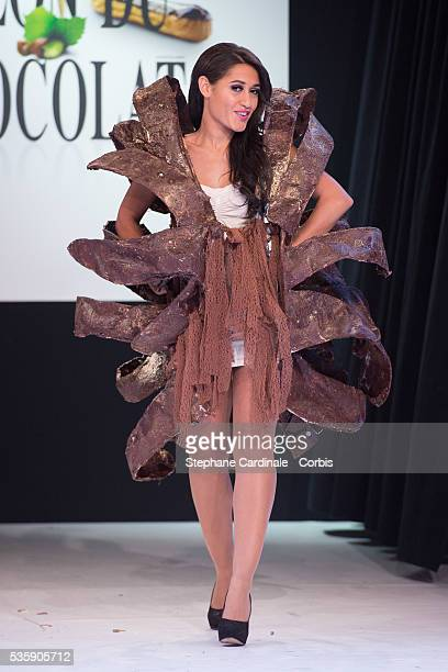 Actress Josephine Jobert walks the runway and wears 'Eclosion' a chocolate dress made by designer Stephane Martello and chocolate maker Bruno Rouly...