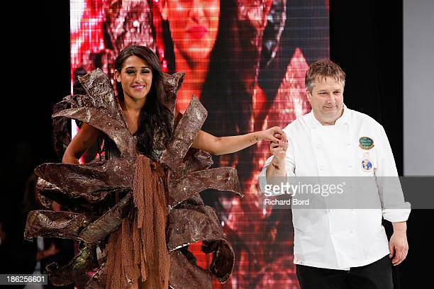 Actress Josephine Jobert walks the runway with chocolate maker Bruno Rouly during the Fashion Chocolate Show at Salon du Chocolat at Portes de...