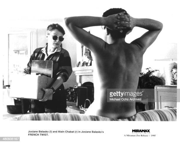 Actress Josiane Balasko and actor Alain Chabat in a scene from the Miramax movie ' French Twist ' circa 1995