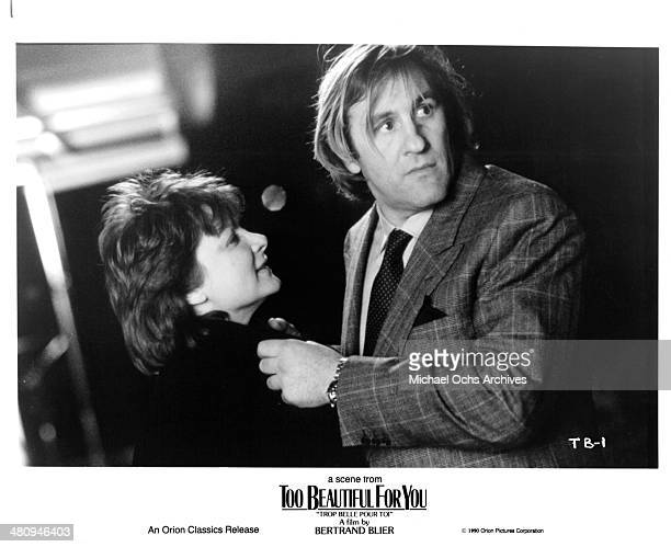 Actress Josiane Balasko and actor Gerard Depardieu in a scene from the Orion Classic movie ' Too Beautiful for You' circa 1989