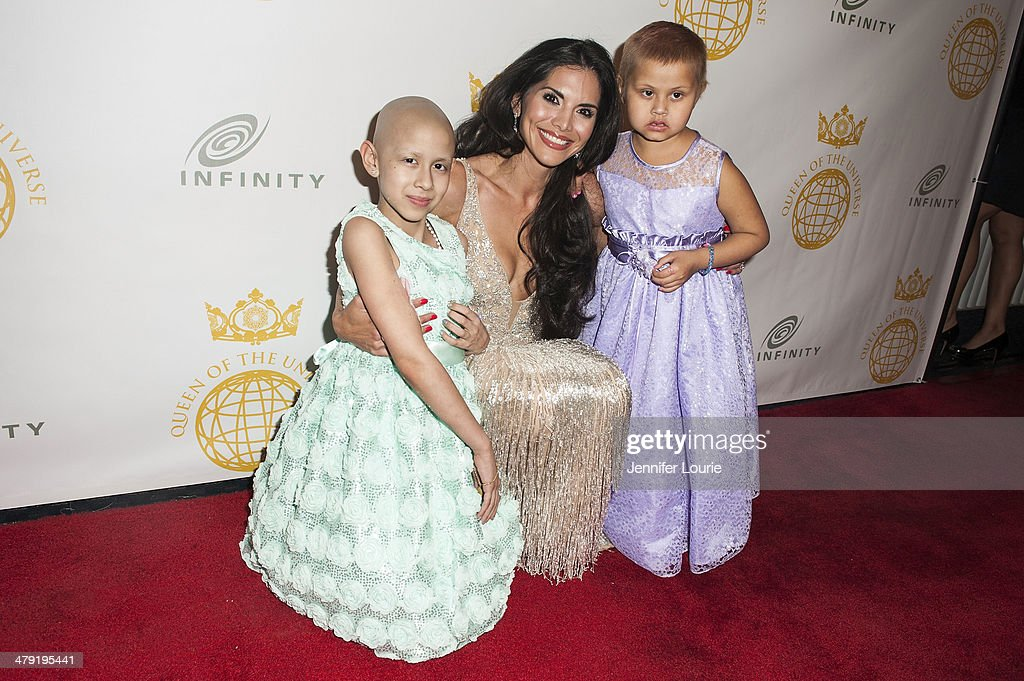 Actress <a gi-track='captionPersonalityLinkClicked' href=/galleries/search?phrase=Joyce+Giraud&family=editorial&specificpeople=841715 ng-click='$event.stopPropagation()'>Joyce Giraud</a> (C) attends the Queen Of The Universe International Beauty Pageant hosted at the Saban Theatre on March 16, 2014 in Beverly Hills, California.