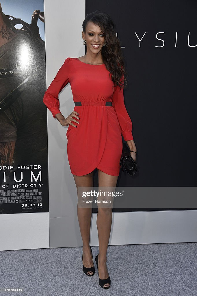 Actress Judi Shekoni arrives at the premiere of TriStar Pictures' 'Elysium' at Regency Village Theatre on August 7, 2013 in Westwood, California.