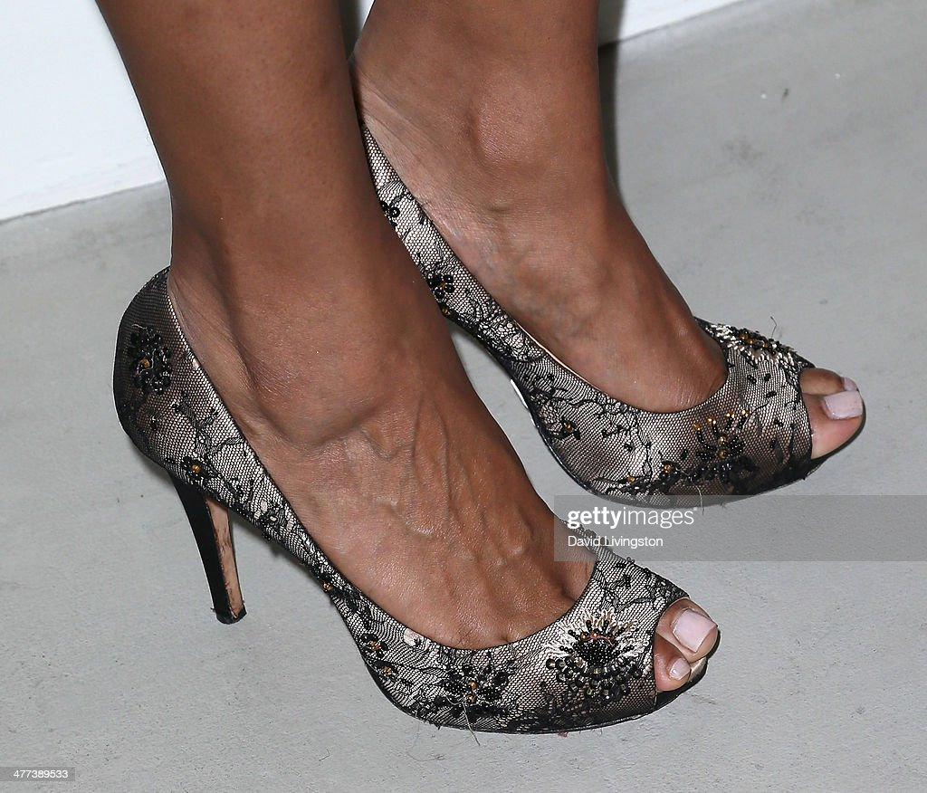 Actress Judi Shekoni (shoe detail) attends the Alexander Yulish 'An Unquiet Mind' VIP opening reception at KM Fine Arts LA Studio on March 8, 2014 in Los Angeles, California.