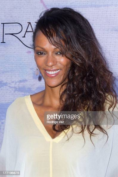 Actress Judi Shekoni attends the artist's reception for Billy Zane's solo art exhibition 'Seize The Day Bed' on August 21 2013 in Los Angeles...