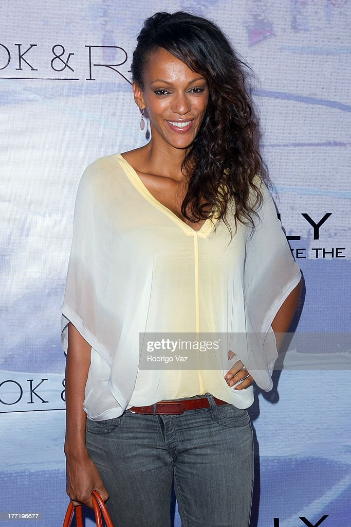 Actress Judi Shekoni attends the artist's reception for Billy Zane's solo art exhibition 'Seize The Day Bed' on August 21, 2013 in Los Angeles, California.