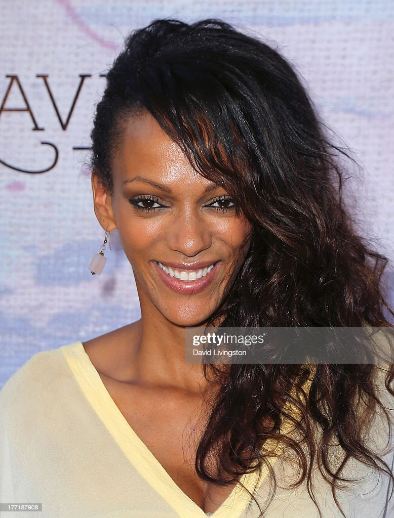 Actress Judi Shekoni attends the opening night of Billy Zane's 'Seize The Day Bed' solo art exhibition at G+ Gulla Jonsdottir Design on August 21, 2013 in Los Angeles, California.