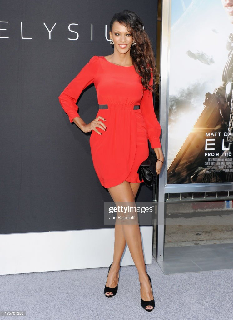 Actress Judith Shekoni arrives at the Los Angeles Premiere 'Elysium' at Regency Village Theatre on August 7, 2013 in Westwood, California.