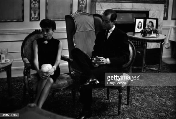 Actress Judy Garland and her husband Mark Herron sitting in their hotel suite in Copenhagen Denmark 1964