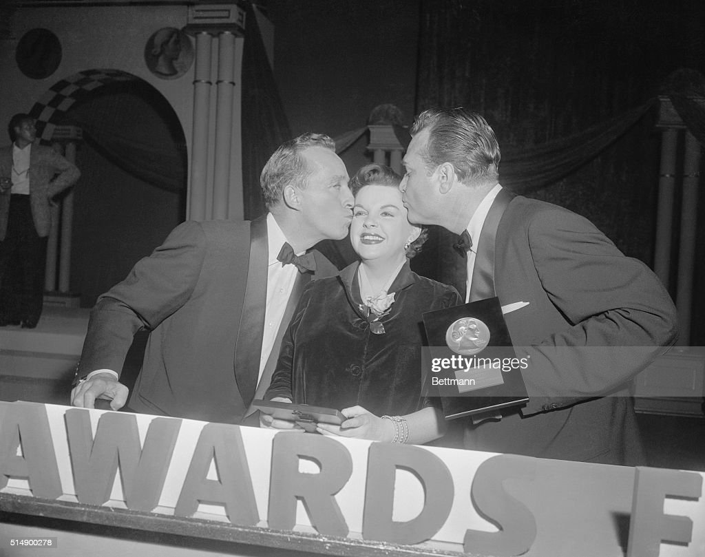Actress <a gi-track='captionPersonalityLinkClicked' href=/galleries/search?phrase=Judy+Garland&family=editorial&specificpeople=91265 ng-click='$event.stopPropagation()'>Judy Garland</a> is kissed by <a gi-track='captionPersonalityLinkClicked' href=/galleries/search?phrase=Bing+Crosby&family=editorial&specificpeople=90412 ng-click='$event.stopPropagation()'>Bing Crosby</a> (l) and <a gi-track='captionPersonalityLinkClicked' href=/galleries/search?phrase=Red+Skelton&family=editorial&specificpeople=208234 ng-click='$event.stopPropagation()'>Red Skelton</a> after she and Bing received the 1955 Look magazine awards for the best actress and actor. Bing's role in The Country Girl and Judy's in A Star Is Born won the awards, which were presented on Skelton's nationwide TV show, The <a gi-track='captionPersonalityLinkClicked' href=/galleries/search?phrase=Red+Skelton&family=editorial&specificpeople=208234 ng-click='$event.stopPropagation()'>Red Skelton</a> Show.
