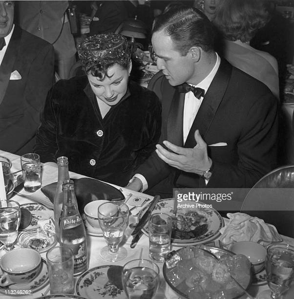 Actress Judy Garland with actor Marlon Brando at the Golden Globe Awards held in Los Angeles California on 24th February 1955