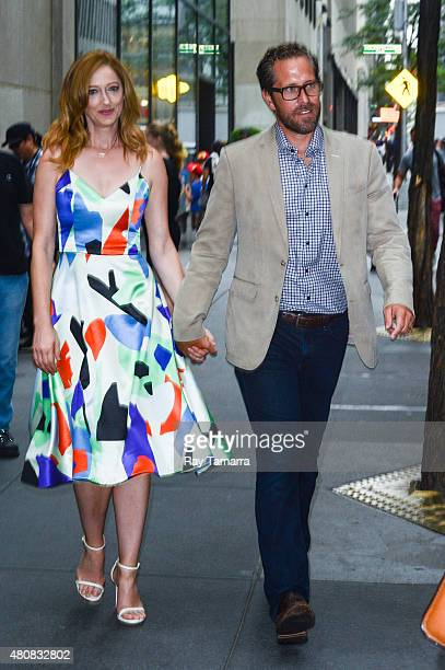 Actress Judy Greer and television producer Dean E Johnsen leave the 'Today Show' taping at the NBC Rockefeller Center Studios on July 15 2015 in New...