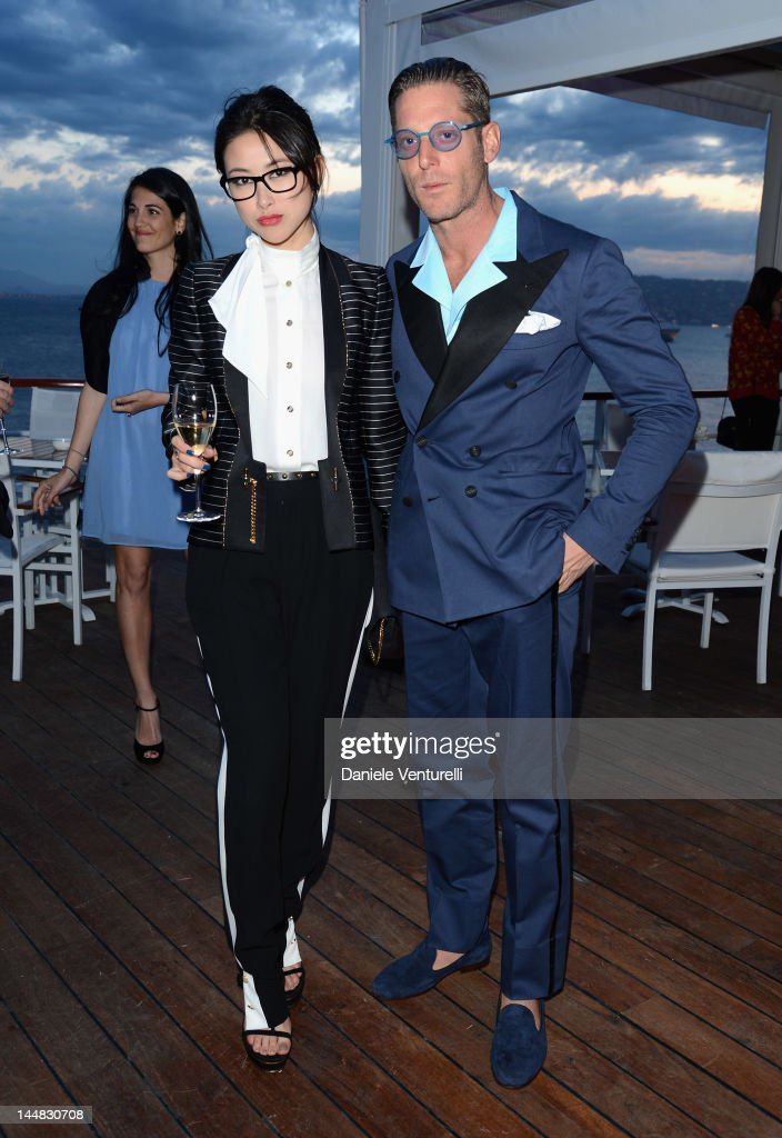 Actress Juju Zhu Zhu and <a gi-track='captionPersonalityLinkClicked' href=/galleries/search?phrase=Lapo+Elkann&family=editorial&specificpeople=771607 ng-click='$event.stopPropagation()'>Lapo Elkann</a> attend the Vanity Fair and Gucci Party at Hotel Du Cap during 65th Annual Cannes Film Festival on May 19, 2012 in Antibes, France.