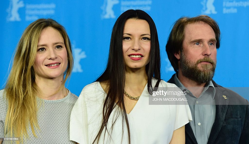 Actress Julia Jentsch, German director Anne Zohra Berrached and actor Bjarne Maedel pose at a photocall for the film '24 Weeks' (24 Wochen) during the 66th Berlinale Film Festival in Berlin on February 14, 2016. Eighteen pictures vie for the Golden Bear top prize at the event which runs from February 11 to 21, 2016. / AFP / John MACDOUGALL