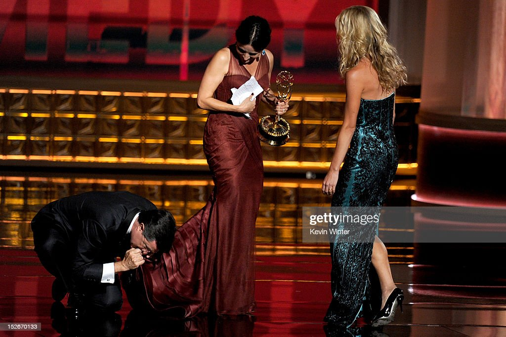 Actress Julia Louis-Dreyfus (C) accepts Outstanding Lead Actress in a Comedy Series award for 'Veep' onstage during the 64th Annual Primetime Emmy Awards at Nokia Theatre L.A. Live on September 23, 2012 in Los Angeles, California.