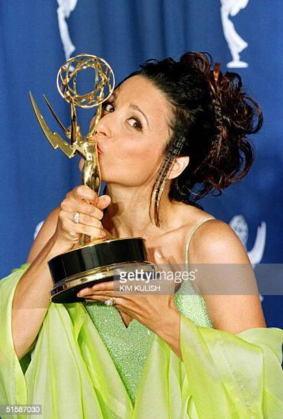 Actress Julia LouisDreyfus from the hit television series 'Seinfeld' kisses her Emmy Award at the 48th Annual Primetime Emmy Awards in Pasadena...