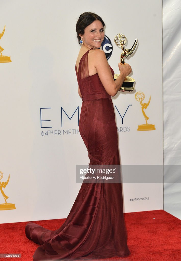Actress Julia Louis-Dreyfus poses in the 64th Annual Emmy Awards press room at Nokia Theatre L.A. Live on September 23, 2012 in Los Angeles, California.