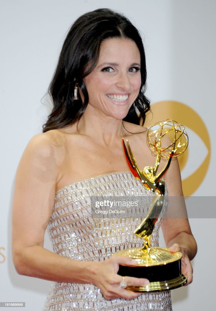Actress <a gi-track='captionPersonalityLinkClicked' href=/galleries/search?phrase=Julia+Louis-Dreyfus&family=editorial&specificpeople=208965 ng-click='$event.stopPropagation()'>Julia Louis-Dreyfus</a> poses in the press room at the 65th Annual Primetime Emmy Awards at Nokia Theatre L.A. Live on September 22, 2013 in Los Angeles, California.