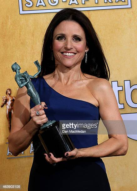 Actress Julia LouisDreyfus poses in the press room with the award for Outstanding Performance by a Female Actor in a Comedy Series for 'Veep' at the...