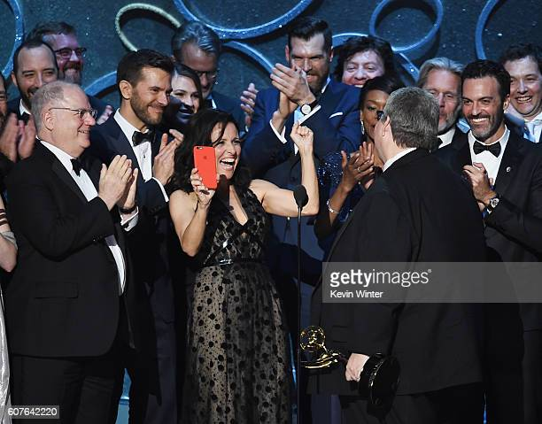 Actress Julia LouisDreyfus producer David Mandel and production team accept Outstanding Comedy Series for 'Veep' onstage during the 68th Annual...