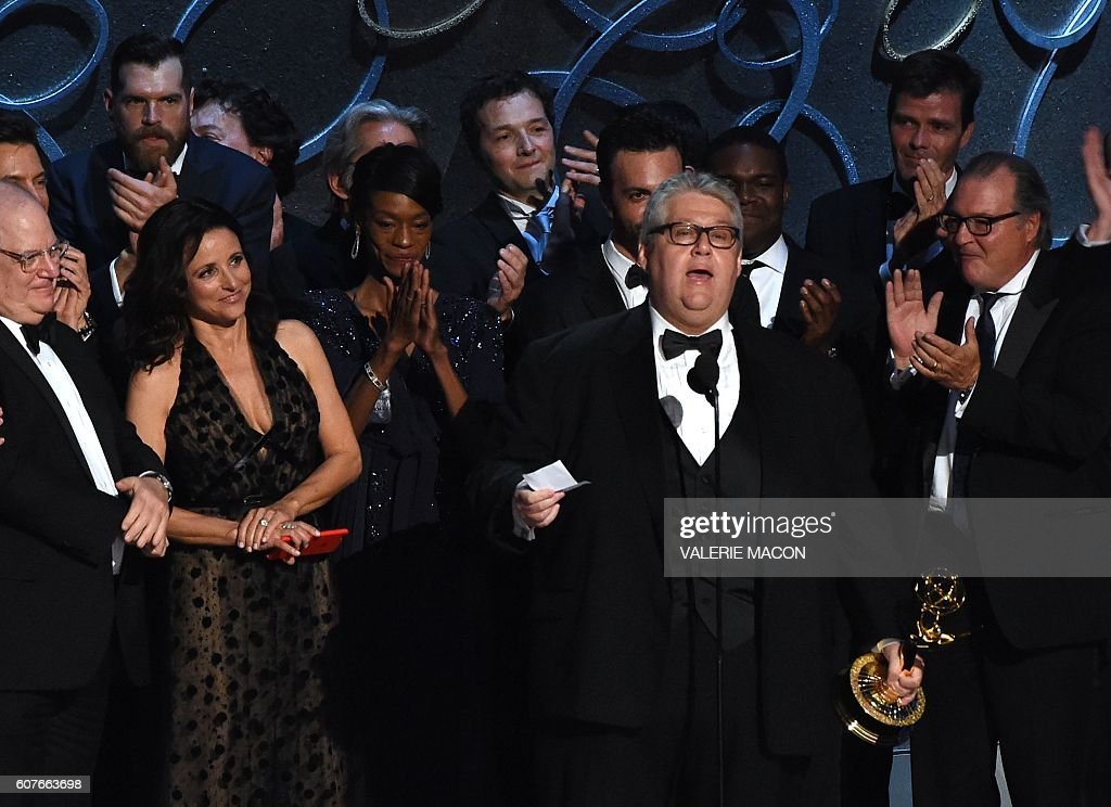 Actress Julia Louis-Dreyfus (2 L), producer David Mandel (2R) and the cast and crew accept the award for Outstanding Comedy Series for 'Veep' during the 68th Emmy Awards show on September 18, 2016 at the Microsoft Theatre in downtown Los Angeles. / AFP / Valerie MACON