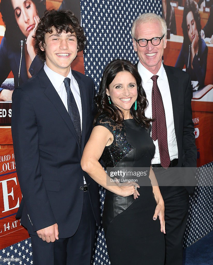 Actress Julia Louis-Dreyfus (C), son Charles Hall (L) and husband writer Brad Hall (R) attend the premiere of HBO's 'VEEP' Season 2 at Paramount Studios on April 9, 2013 in Hollywood, California.