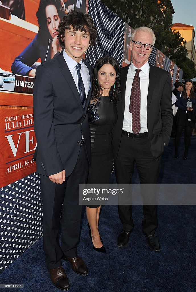 Actress Julia Louis-Dreyfus (C), son Charles Hall (L) and husband writer Brad Hall (R) attend the Los Angeles premiere for the second season of HBO's series 'Veep' at Paramount Studios on April 9, 2013 in Hollywood, California.