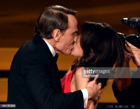 Actress Julia LouisDreyfus wins Outstanding Lead Actress in a Comedy Series for 'Veep' and kisses actor Bryan Cranston onstage at the 66th Annual...