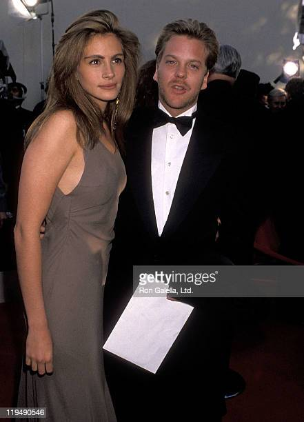 Actress Julia Roberts and actor Kiefer Sutherland attend the 62nd Annual Academy Awards on March 26 1990 at Dorothy Chandler Pavilion Music Center in...