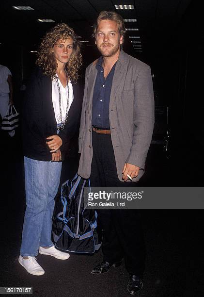 Actress Julia Roberts and actor Kiefer Sutherland depart for North Carolina on June 10 1990 at Los Angeles International Airport in Los Angeles...