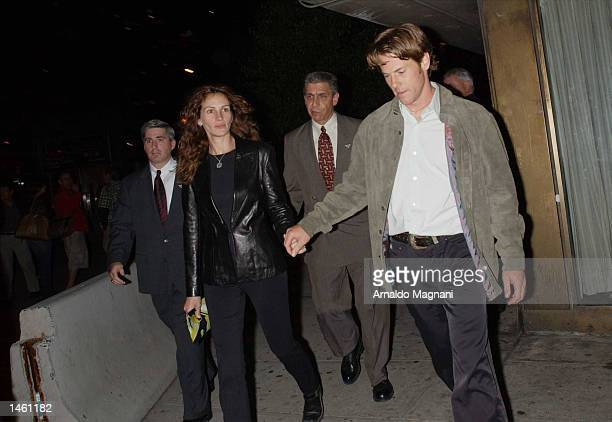 Actress Julia Roberts and husband Danny Moder leave the screening of 'PunchDrunk Love' at Alice Tully Hall during the 10th Annual New York Film...