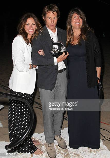 Actress Julia Roberts Daniel Moder and a guest attend Heal The Bay's Bring Back The Beach Fundraiser on May 17 2012 in Santa Monica California
