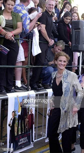 Actress Julia Roberts greets fans as she arrives at the premiere of 'America''s Sweethearts' July 17 2001 in Los Angeles CA