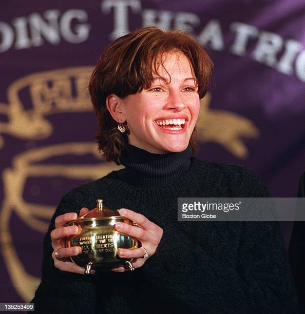 Actress Julia Roberts holds the pudding pot award she received as the Hasty Pudding Theatricals Woman of the Year during ceremonies at the Hasty...