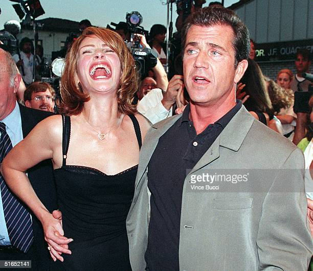 US actress Julia Roberts laughs as actor Mel Gibson poses for photographers at the premiere of their new film 'Conspiracy Theory' 04 August in Los...
