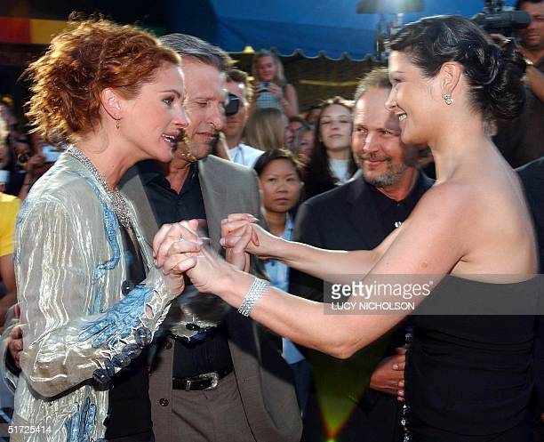 US actress Julia Roberts meets Welsh actress Catherine ZetaJones at the premiere of their new film 'America's Sweethearts' as costar US Billy Crystal...