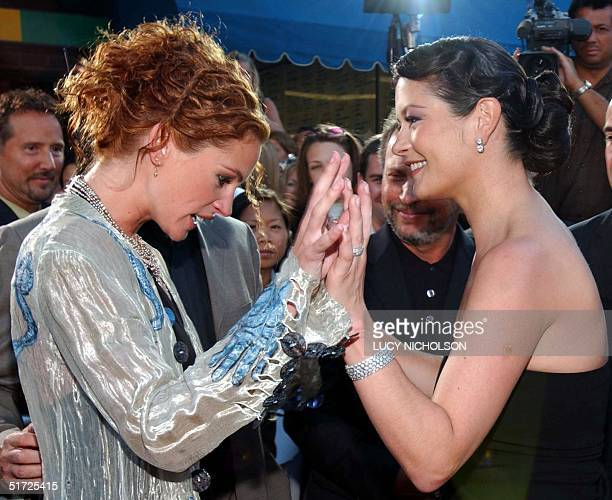 US actress Julia Roberts meets Welsh actress Catherine ZetaJones at the premiere of their new film 'America's Sweethearts' in Los Angeles CA 17 July...