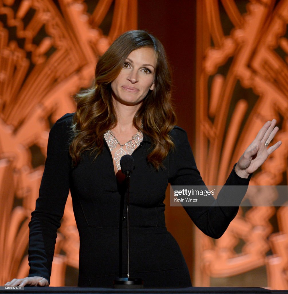 Actress <a gi-track='captionPersonalityLinkClicked' href=/galleries/search?phrase=Julia+Roberts&family=editorial&specificpeople=202605 ng-click='$event.stopPropagation()'>Julia Roberts</a> onstage at the 40th AFI Life Achievement Award honoring Shirley MacLaine held at Sony Pictures Studios on June 7, 2012 in Culver City, California. The AFI Life Achievement Award tribute to Shirley MacLaine will premiere on TV Land on Saturday, June 24 at 9PM