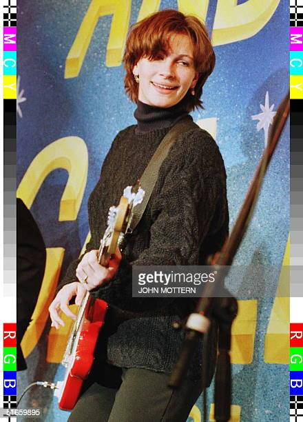 Actress Julia Roberts plays the guitar during an appearance 13 February where she was honored by the Harvard University Hasty Pudding Theatricals as...