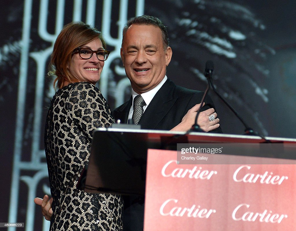 Actress <a gi-track='captionPersonalityLinkClicked' href=/galleries/search?phrase=Julia+Roberts&family=editorial&specificpeople=202605 ng-click='$event.stopPropagation()'>Julia Roberts</a> presents the Chairman's Award to actor <a gi-track='captionPersonalityLinkClicked' href=/galleries/search?phrase=Tom+Hanks&family=editorial&specificpeople=201790 ng-click='$event.stopPropagation()'>Tom Hanks</a> onstage during the 25th annual Palm Springs International Film Festival awards gala at Palm Springs Convention Center on January 4, 2014 in Palm Springs, California.