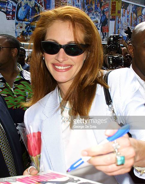 Actress Julia Roberts signs an autograph as she arrives at the Ed Sullivan Theater to appear as a guest on the Late Show with David Letterman July 10...