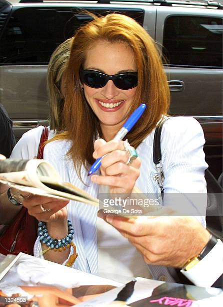 Actress Julia Roberts signs autographs a she arrives at the Ed Sullivan Theater to appear as a guest on the Late Show with David Letterman July 10...