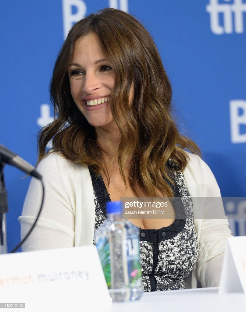 Actress <a gi-track='captionPersonalityLinkClicked' href=/galleries/search?phrase=Julia+Roberts&family=editorial&specificpeople=202605 ng-click='$event.stopPropagation()'>Julia Roberts</a> speaks onstage at 'August: Osage County' Press Conference during the 2013 Toronto International Film Festival at TIFF Bell Lightbox on September 10, 2013 in Toronto, Canada.