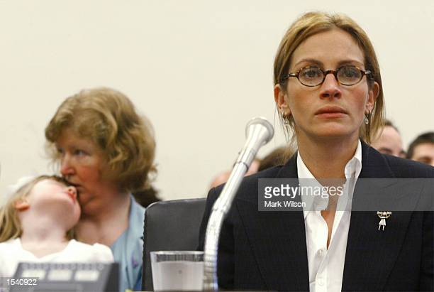 Actress Julia Roberts testifies before the House Appropriations SubCommittee on the RETT syndrome as Donna Genzlinger holds her daughter Abby who has...
