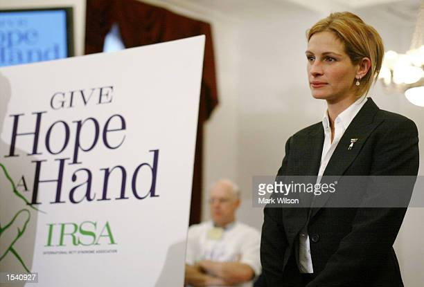 Actress Julia Roberts waits to speak at a news conference after testifying before the House Appropriations SubCommittee on the RETT syndrome May 9...