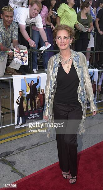 Actress Julia Roberts walks past fans as she attends the film premiere of Colombia Pictures'' 'America''s Sweethearts' July 17 2001 in Los Angeles CA