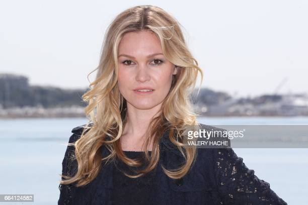 US actress Julia Stiles who stars in the series ''Riviera' poses during a photocall as part of the MIPTV event on April 3 2017 in Cannes southeastern...