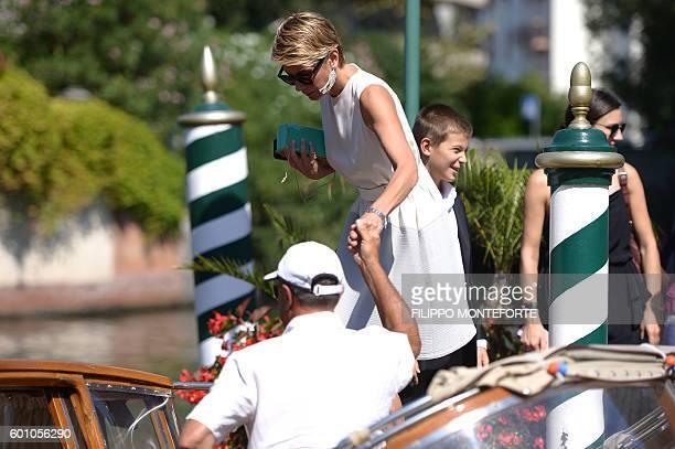 Actress Julia Vysotskaya leaves the Excelsior Hotel during the 73rd Venice Film Festival on September 9 2016 at Venice Lido / AFP / FILIPPO MONTEFORTE