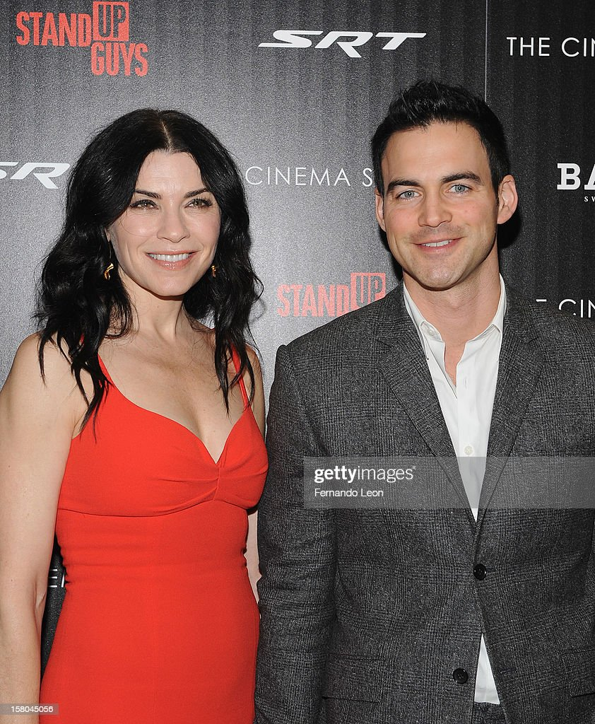 Actress Julianna Margulies and her husband Keith Lieberthal (R) attend the premiere of 'Stand Up Guys' hosted by The Cinema Society with Chrysler and Bally at MOMA on December 9, 2012 in New York City.