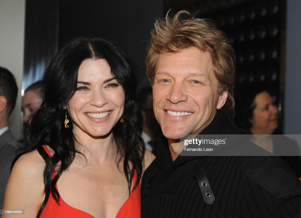 Actress Julianna Margulies and musician <a gi-track='captionPersonalityLinkClicked' href=/galleries/search?phrase=Jon+Bon+Jovi&family=editorial&specificpeople=201527 ng-click='$event.stopPropagation()'>Jon Bon Jovi</a> (R) attend the premiere of 'Stand Up Guys' hosted by The Cinema Society with Chrysler and Bally at MOMA on December 9, 2012 in New York City.